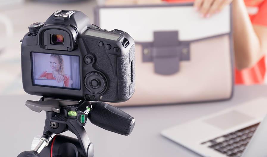 camera photographing handbag