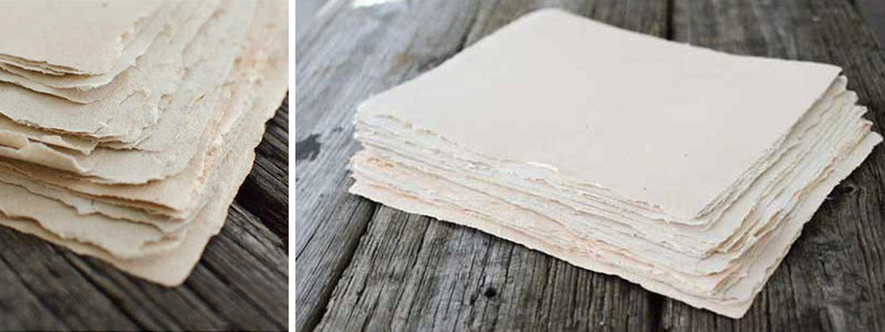 Textured, handmade paper on wooden boards