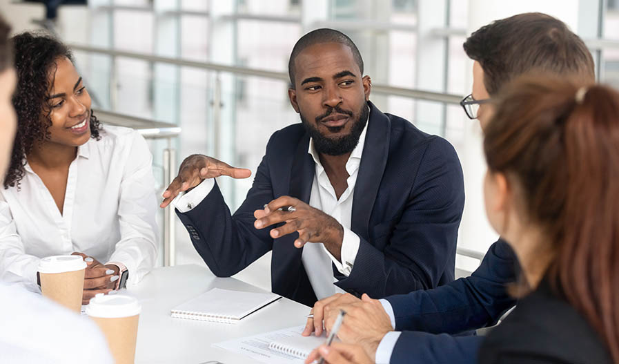 man talking during a meeting about B2B buyer personas